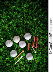 golf ball driver and tee on green g