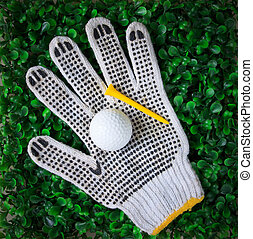 golf ball hand gloves and yellow te