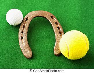 Golf ball, horseshoe, tennis ball