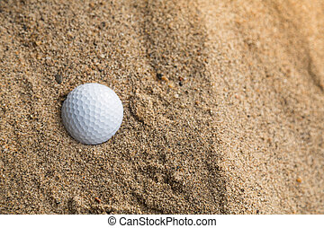 Golf ball in sand bunker