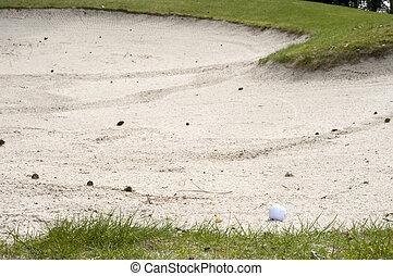 golf ball in the sandbank