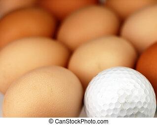 Golf ball lying among the eggs.