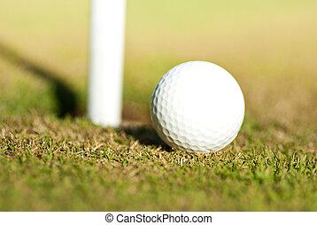 golf ball neer the hole