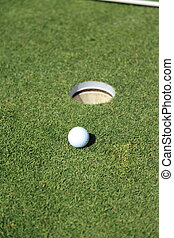 golf ball on a green of a beautiful golf course