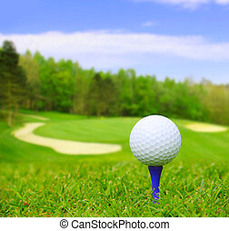 Golf ball on course with beautiful blurry landscape on...