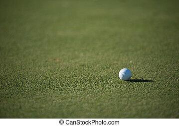 golf ball on grass