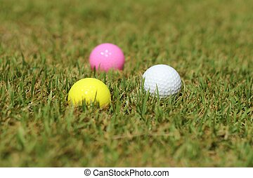 Golf ball on grass