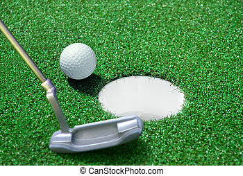 golf ball on green course - golf ball and tee on green...