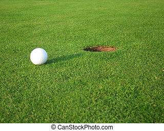 golf ball on its way in the hole