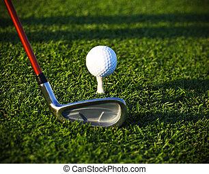 Golf ball on tee and driver