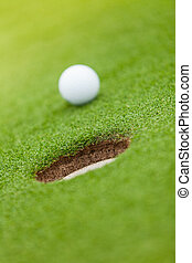 Golf ball on the edge of hole