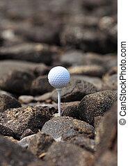 Golf ball on the rocks