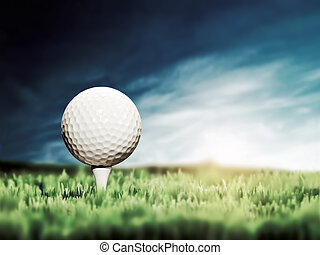 Golf ball placed on white golf tee on green grass golf...
