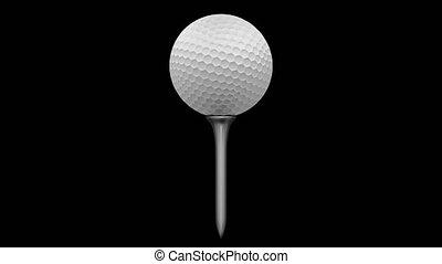 Golf ball rotating on a tee
