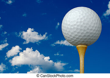 Golf Ball & Tee with clouds and sky background - room for...