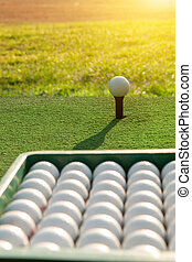 Golf balls on green grass background