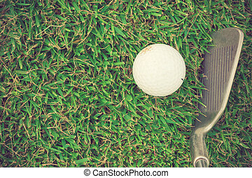 Golf club and ball in grass vintage color