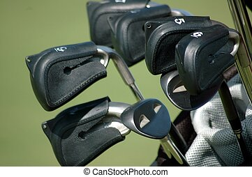 Photographed golf clubs with covers at a local course in Florida.