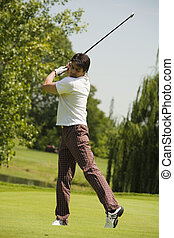 Golf club: golfer concentrating on the hole-in-one