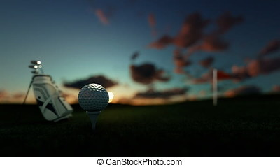 Golf clubs and golf ball on tee with red flag against...