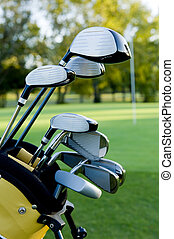 Golf Clubs and Golf Course - A set of golf clubs on a golf...