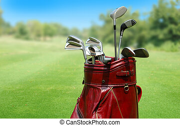 Golf clubs in a bag with course in background