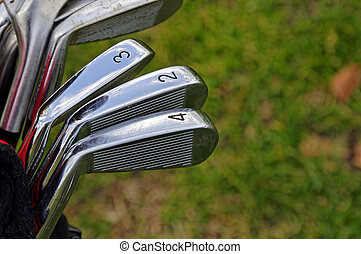 Golf Clubs - Golf clubs (irons) with scuff marks.