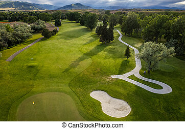Golf Course Aerial - Aerial view of a beautiful green golf ...