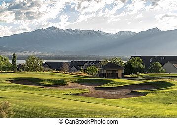 Golf course and residential area overlooking the lake mountain and valley