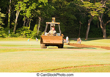 Golf Course Consruction - A bulldozer working on a resort ...