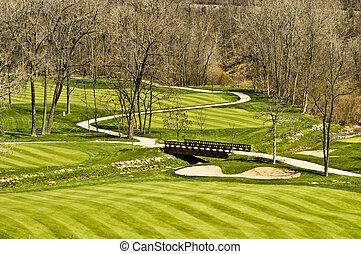 Golf course fairway and bridge
