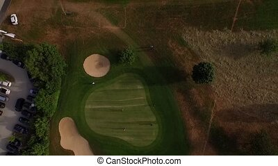 golf course filmed by a drone - drone slowly flying high...