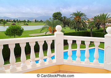Golf course view from house with pool white balustrade