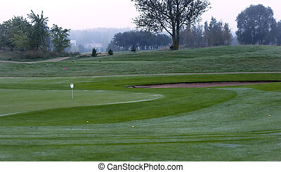 Golf course in morning dew