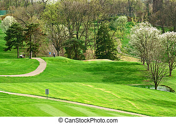 Golf Course In Springtime - Two men playing golf in early...