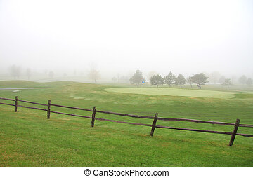 Golf course in the mist