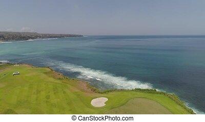 Golf course on coastline bali, indonesia - aerial view golf...