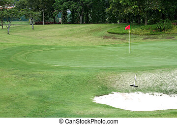 Golf course, tropical greens and sand trap