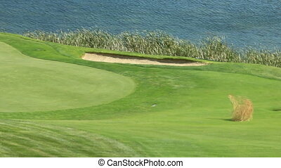 golf course tumbleweed - Tumbleweed blows across a golf...
