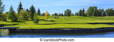Golf Course - Two golf carts on a warm summer day at the...