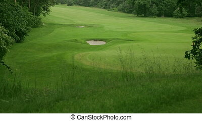 golf course with sand traps - view above a golf course in...