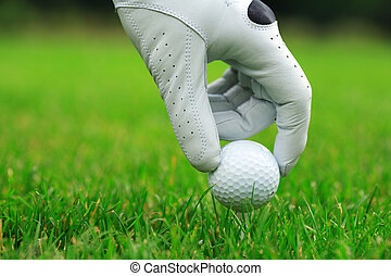 Golf - Detail of golf ball and gloves
