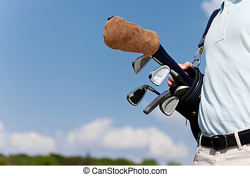 golf equipment against blue sky