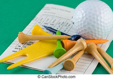 golf ball, tees and scorecard