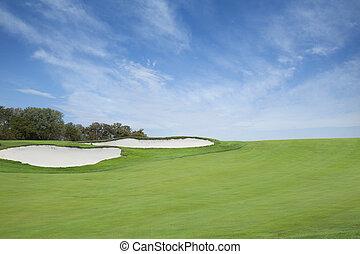 Golf fairway sand traps blue sky - A green golf fairway with...