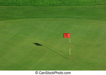 Golf field with red flag