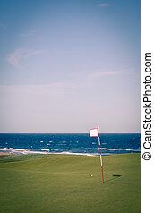 golf flag overlooking the ocean