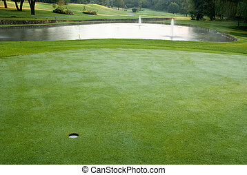 Golf green and water hazard