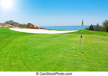 Golf green field on the background of the sea. In the summer in Portugal.