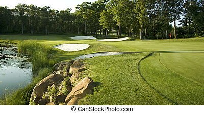 Golf green with traps and water - Golf green with traps...